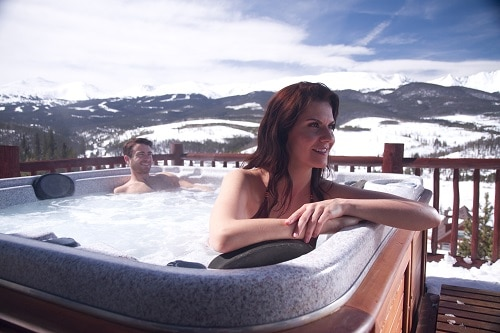 A couple enjoying a hot tub.