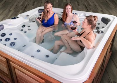 Neighbours and ladies enjoying a hot tub together in the evening