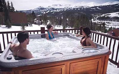 Friends chatting in a Arctic Spas hot tub