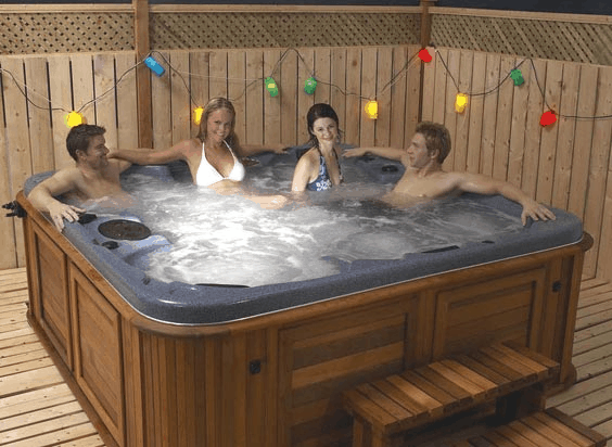Friends relaxing in an arctic spas hot tub on patio