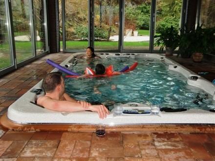 Family having fun it an Indoor swimming pool