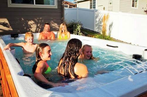 Family having fun in a swim spa