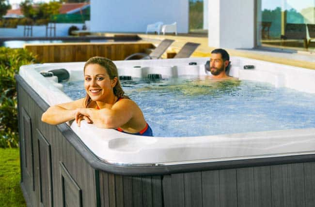 A couple relaxing in the swim spa.