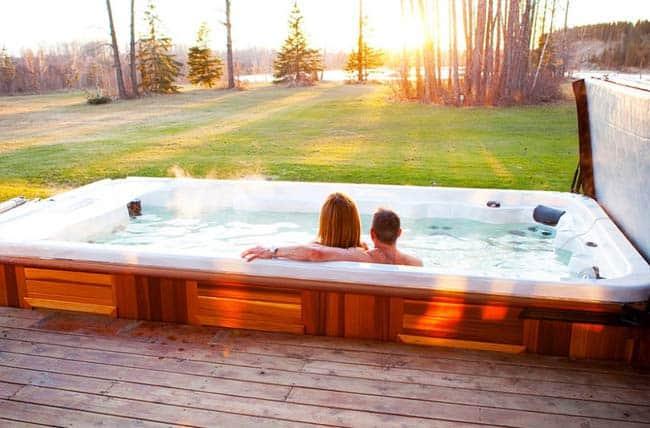 Couple having fun in a Hudson swim spa